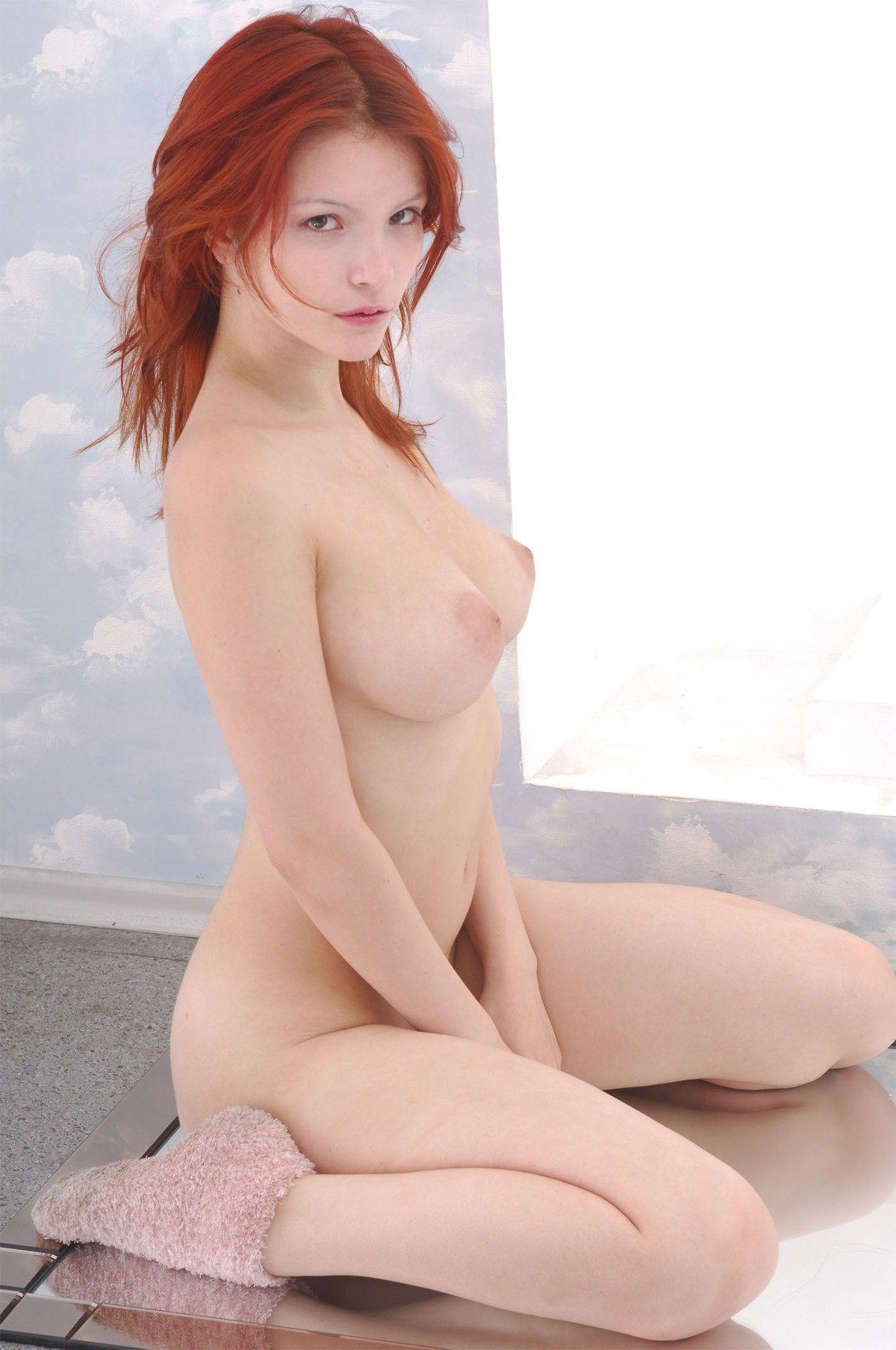 Sexy young redhead perky tits
